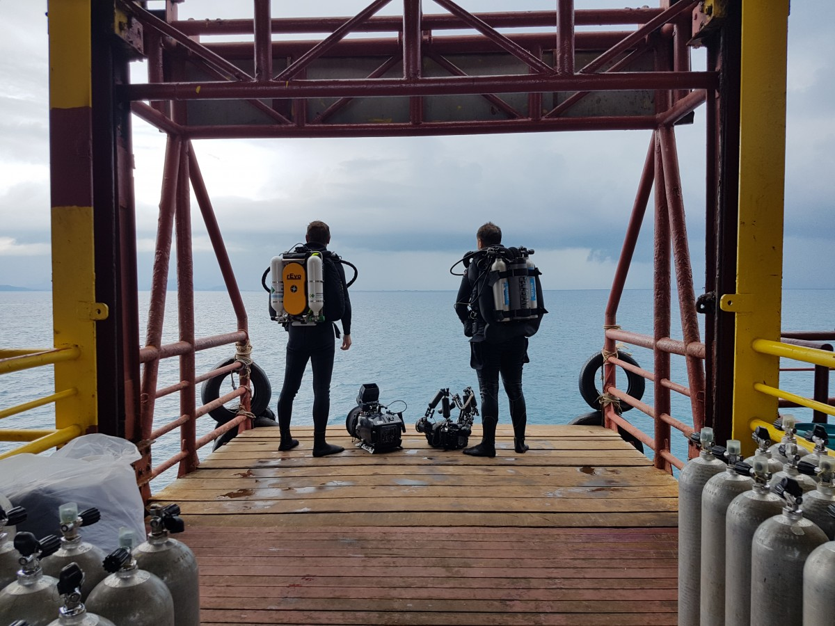 Roger Munns and Jason Isley wearing the rEvo Expedition and Pelagian DCCCR respectively on the lift at Seaventures dive platform